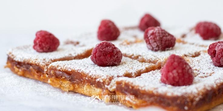 Side view of sliced raspberry lemon bars as an easy summer dessert recipe