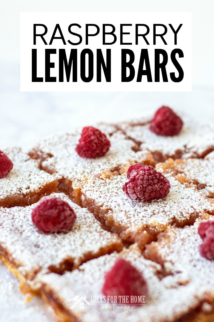 Raspberry Lemon Bars, this delicious summer dessert is cut into individual servings and topped with fresh raspberries and powdered sugar.