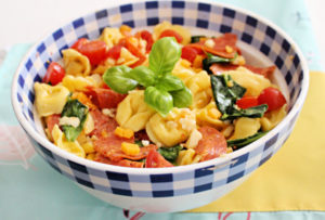 tuscan tortellini pasta salad in blue and white bowl