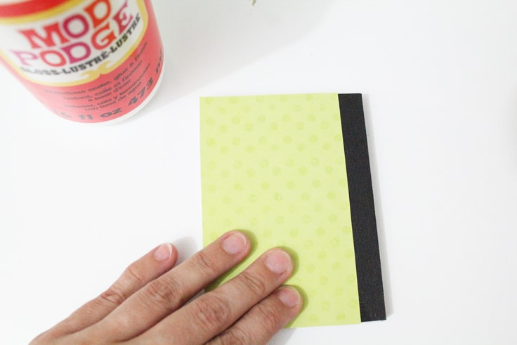 Gluing the back cover onto the notebook