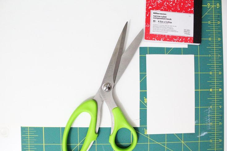 Scissors beside a cutout corner of paper