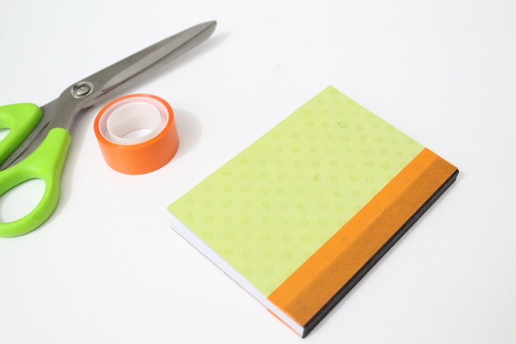 Notebook back cover with washi tape along the edge