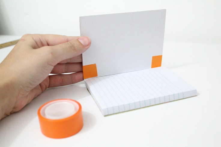 Inside cover of the open notebook showing tape edges folded in