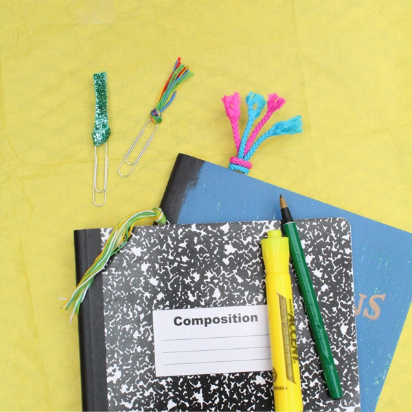 Composition books with assorted tassel bookmarks in the top