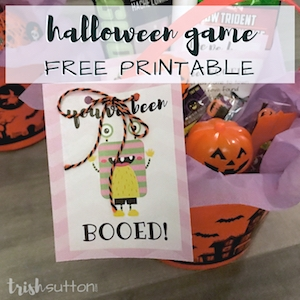 Halloween bucket filled with party favors; You've Been Booed note attached.