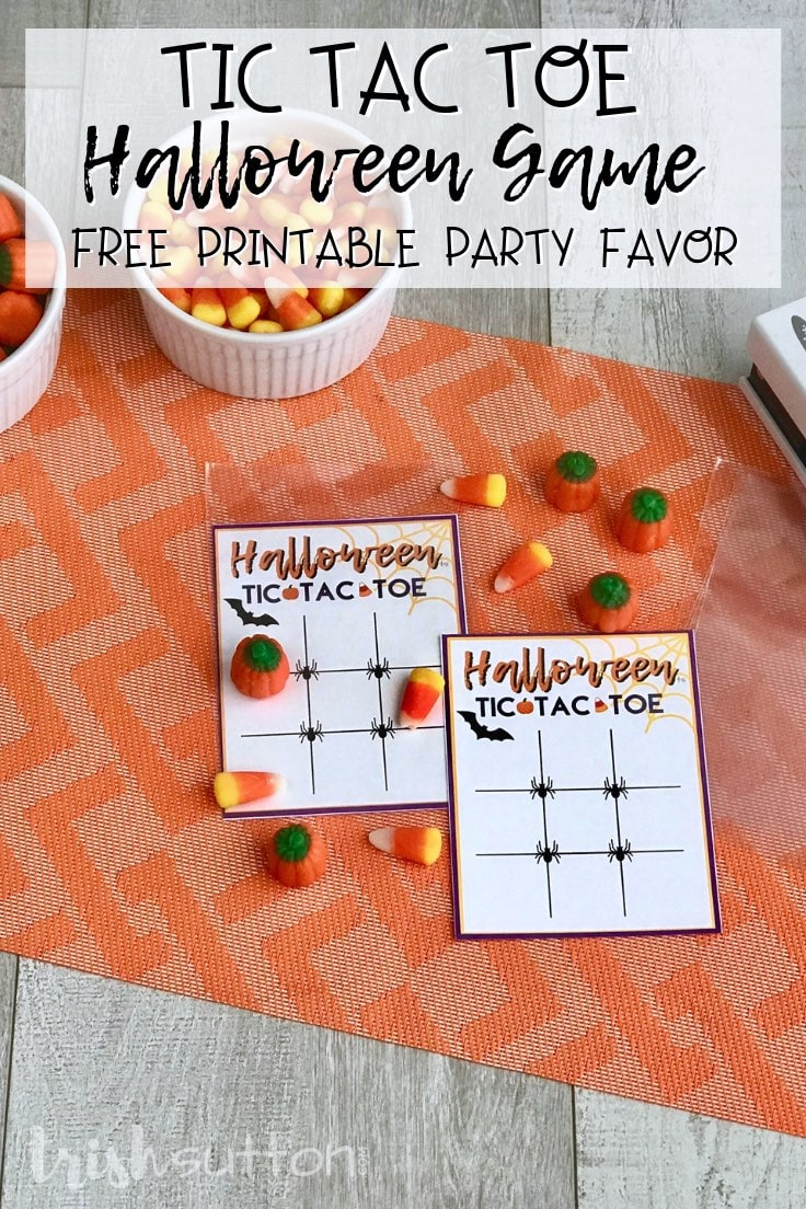 Free printable tic tac toe cards with clear party favor bag and candy on an orange background.