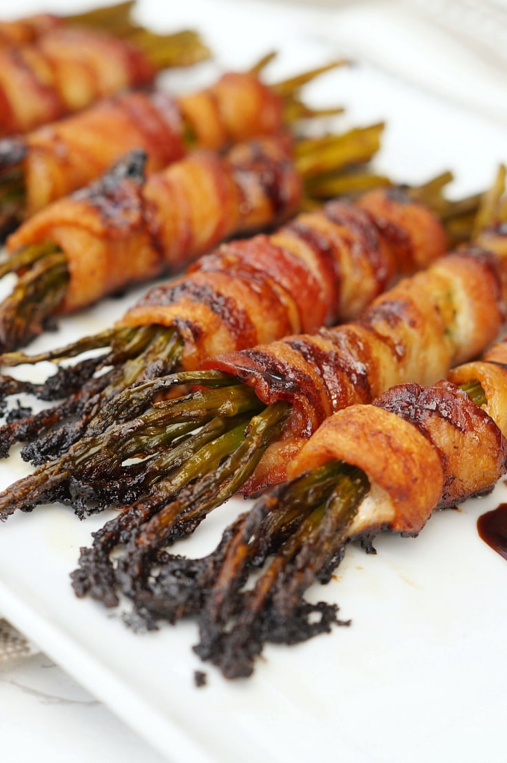 A close up of bacon-wrapped asparagus.