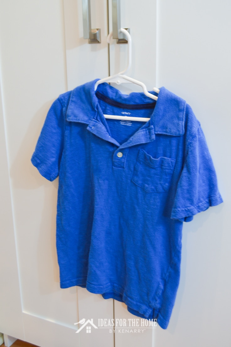 A plain blue short sleeve polo shirt on a hanger
