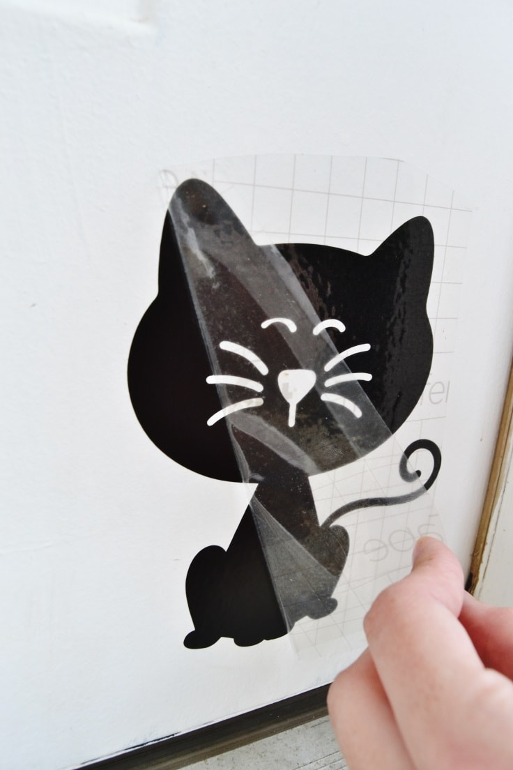 peeling off of the clear transfer tape