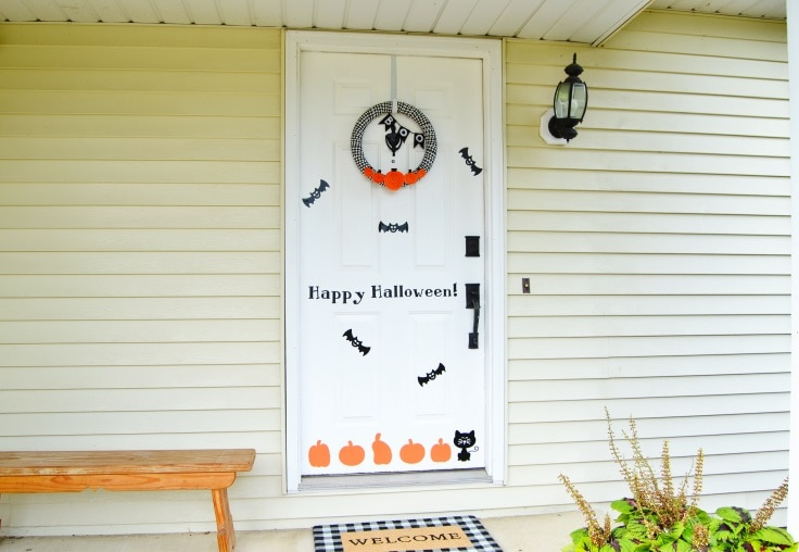 a wide shot of the front porch with Halloween decorations