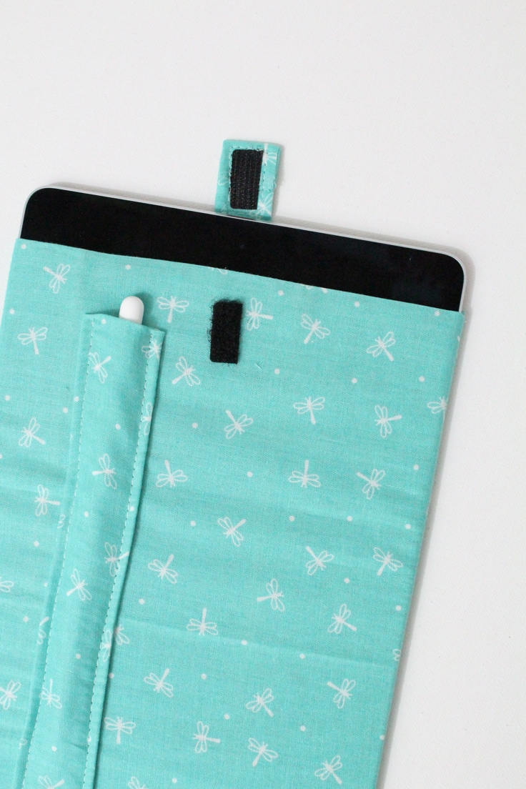 iPad cover made from light blue fabric with white dragonflies