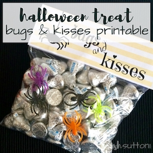 Bugs & kisses in a party favor bag with printable Halloween note on a black background.