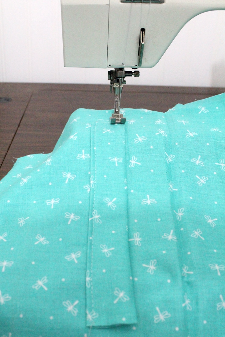 Sewing a small piece of fabric onto a larger piece of fabric
