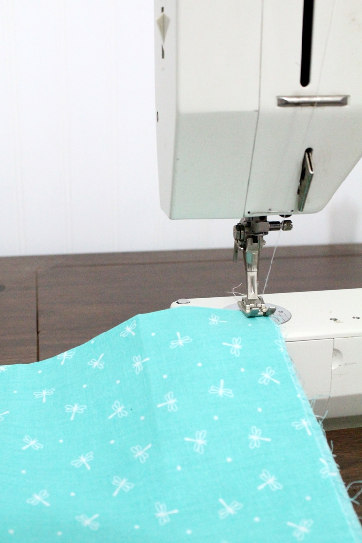 hemming the iPad cover fabric with a sewing machine