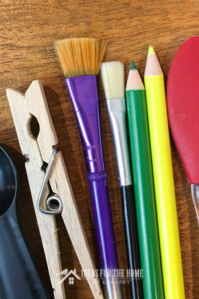 Paint brushes, colored pencils, a spatula, teaspoon and clothespin used by the Kenarry Creative Team to make recipes, crafts and DIY projects.