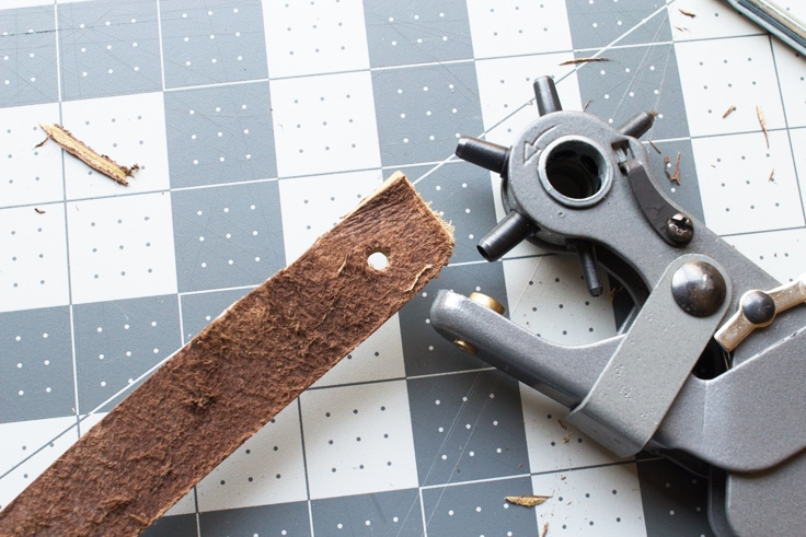punch a hole in leather with a leather hole pinch tool
