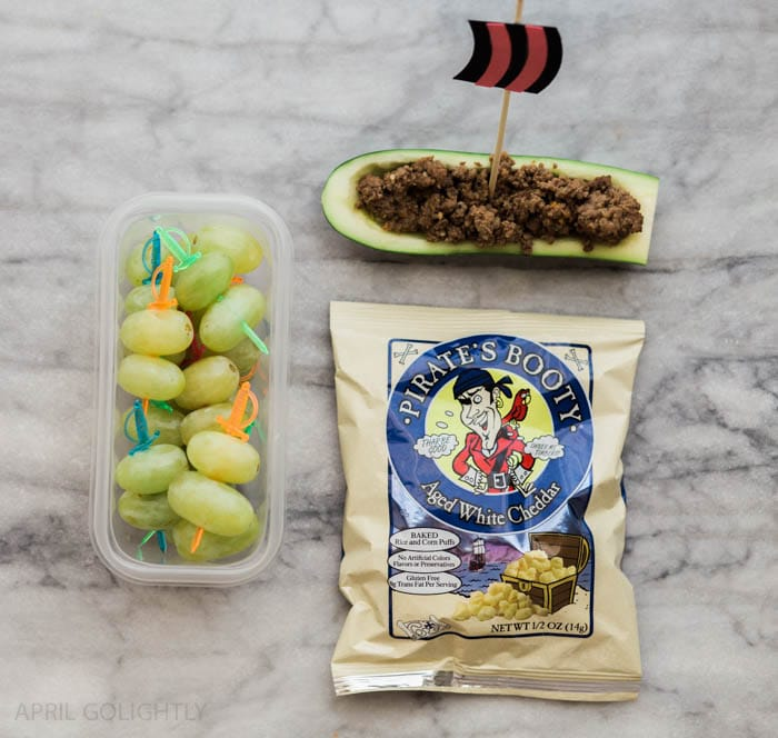 Zucchini boat, grapes, and pirate's booty snacks for a school lunch