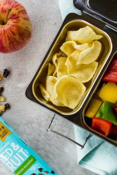 trail mix, an apple, garbanzo beans, peppers and chips for a delicious and creative school lunch