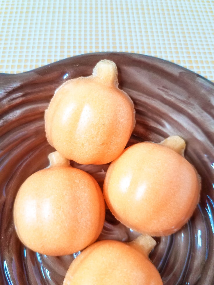 close up of pumpkin sugar scrub in chocolate basket