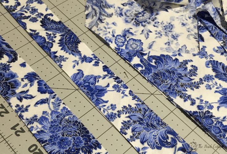 Blue floral fabric cut for a bar stool