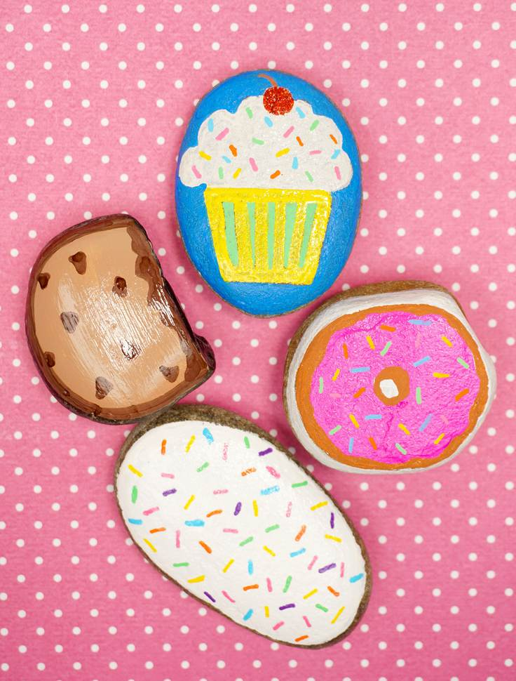 4 painted rocks - a cookie, a cupcake, a donut and a donut with sprinkles