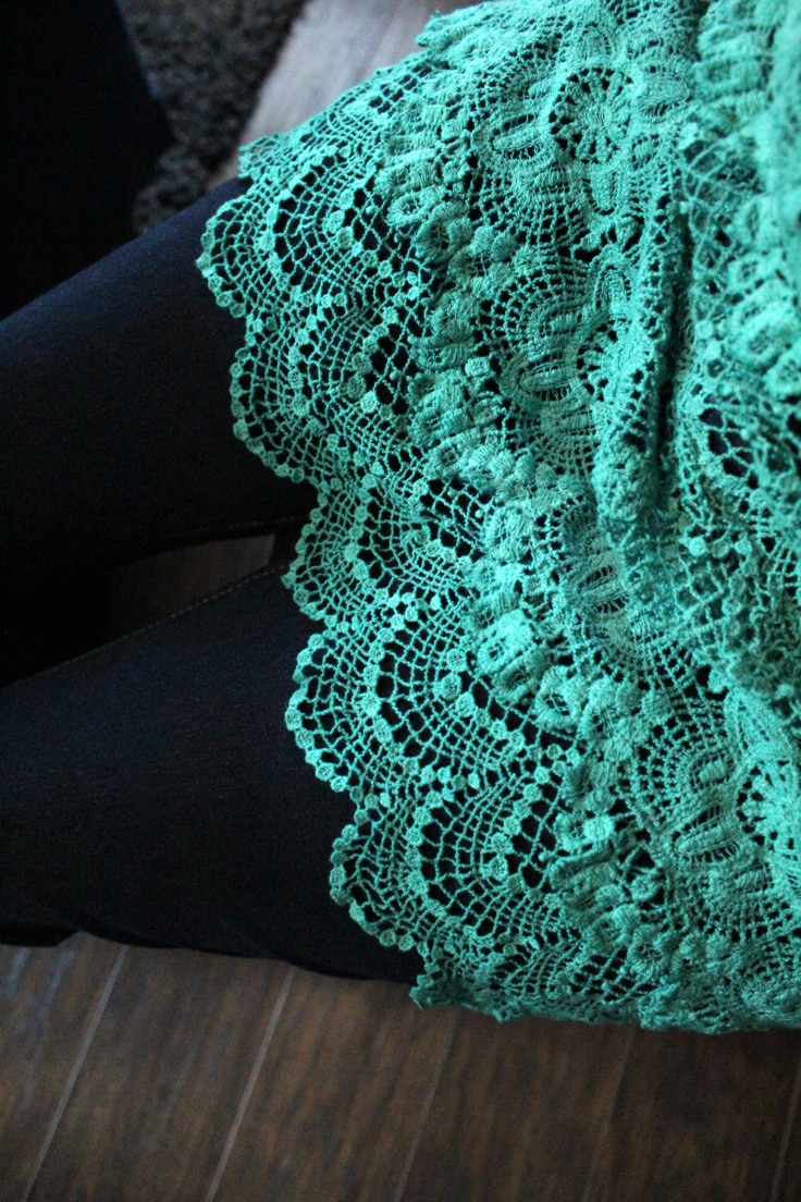 closeup of green tunic fringe against dark blue denim pants after the dip dye
