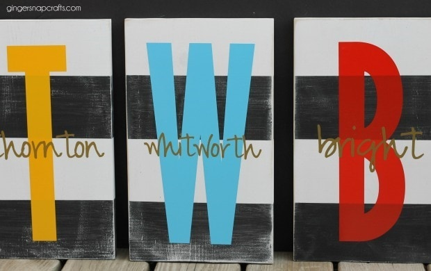 3 hand painted family name signs