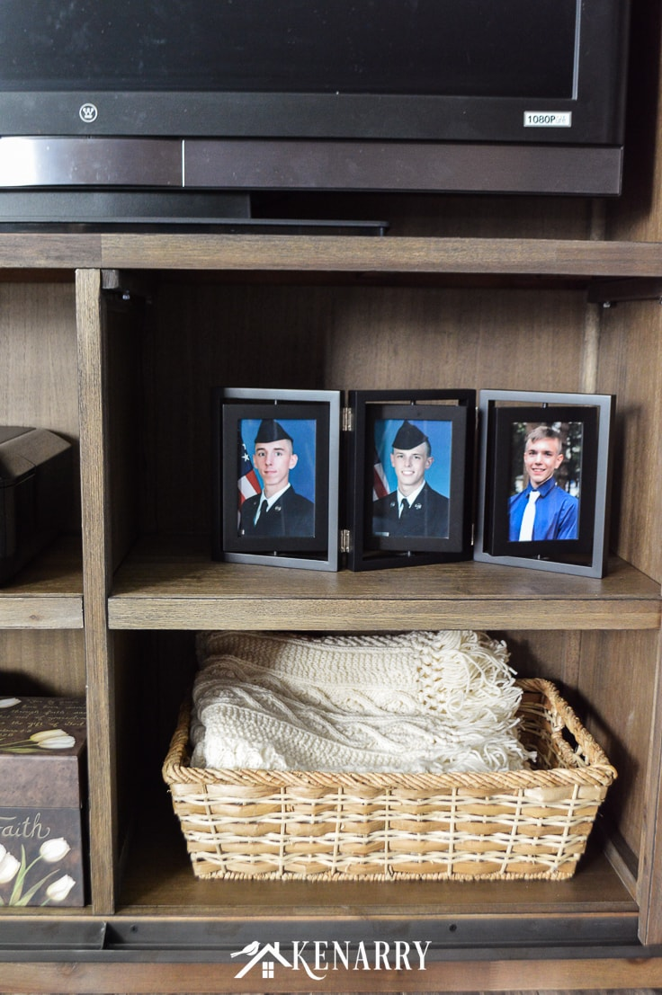Cream colored knit blanket in a basket, photos of young men in the Air Force
