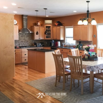 Orange kitchen with natural maple cabinets and hickory floor