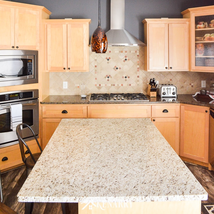 Giallo Ornamental granite with natural maple cabinets in a kitchen