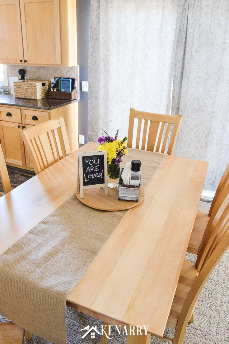 Burlap table runner on a natural maple dining room table with mission style chairs