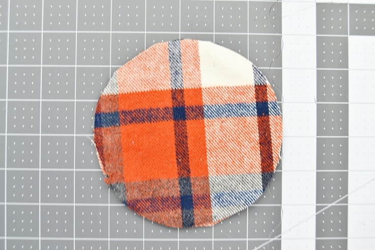 the second outside fabric circle on top of the first, with the right side down