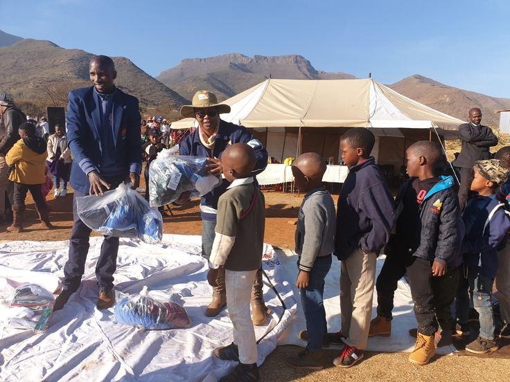 Children in Lesotho receiving towels to keep them warm to get to school through a partnership between World Vision and Thirty-One Gifts