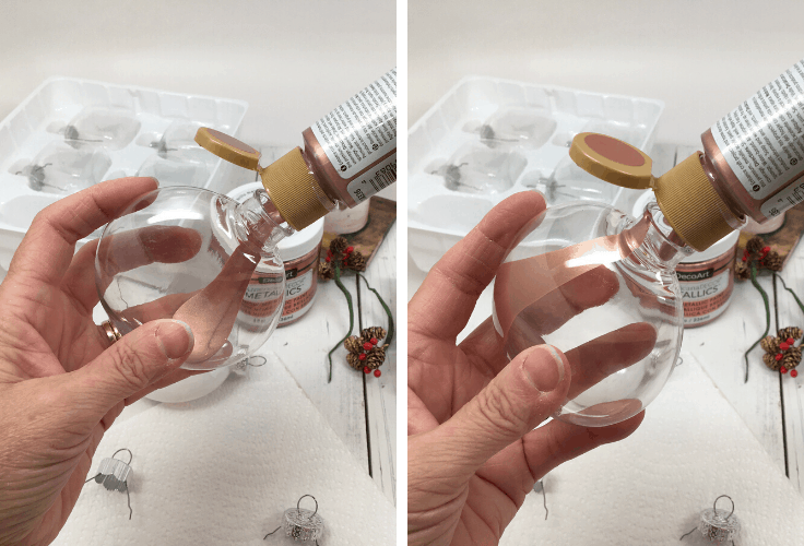 Squeezing paint into clear ornaments