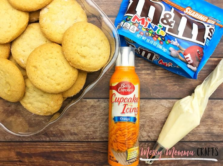 Orange cupcake icing, sugar cookies, and m&m minis - everything you need to decorate snowman cookies