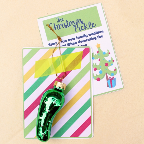 glass pickle ornament taped to a card with a story about the Christmas pickle