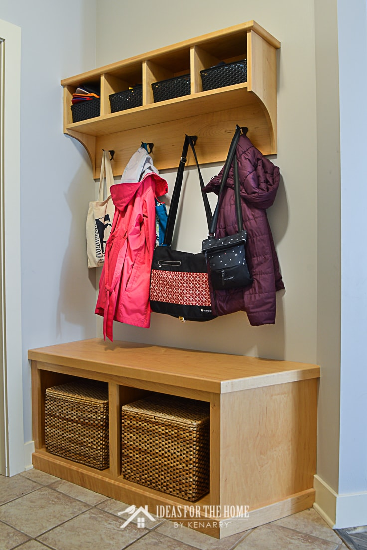 Natural maple coat rack and bench in a mudroom