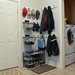Coat hooks and a shoe rack to organize a mudroom