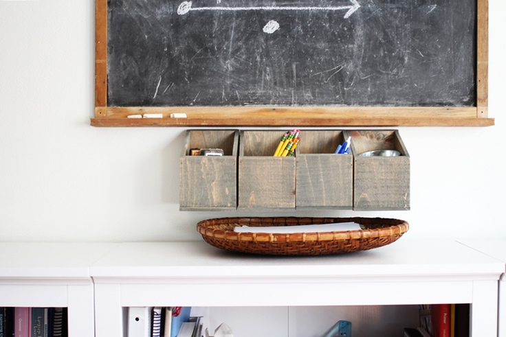 Hanging wall organizer holding office supplies