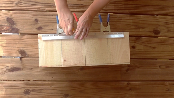 Attach a cleat to the wall organizer