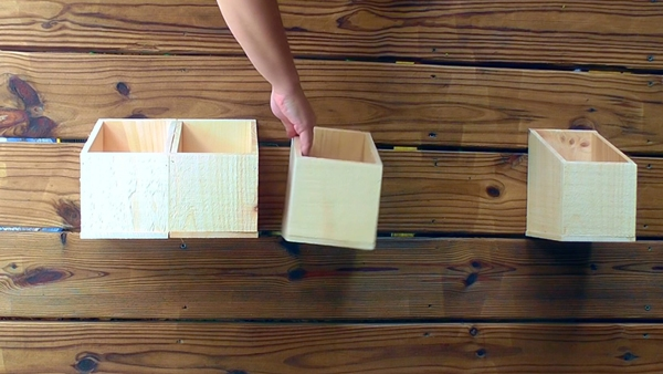 Align 4 wood bins evenly to make a wall organizer