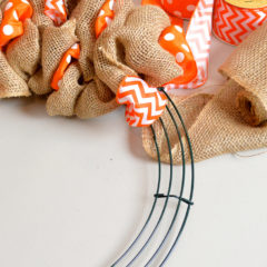 A wire wreath frame being used to make a burlap wreath as an afternoon craft project