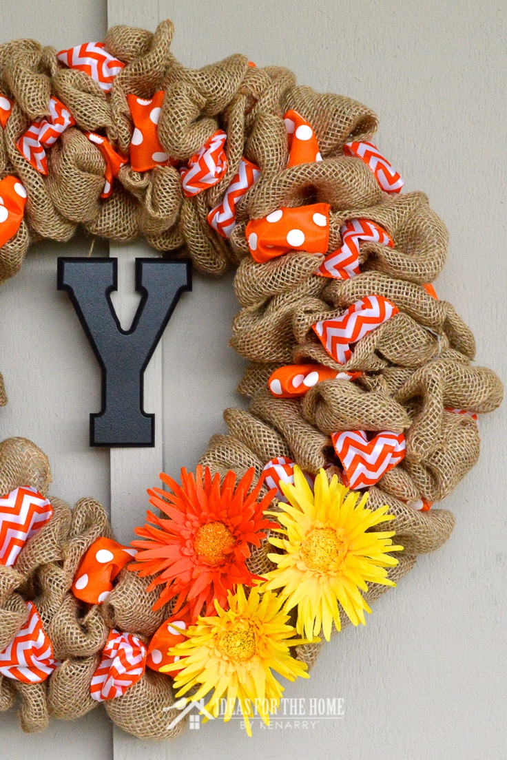 Burlap Ribbon Wreath with two different accent ribbons and three large flowers