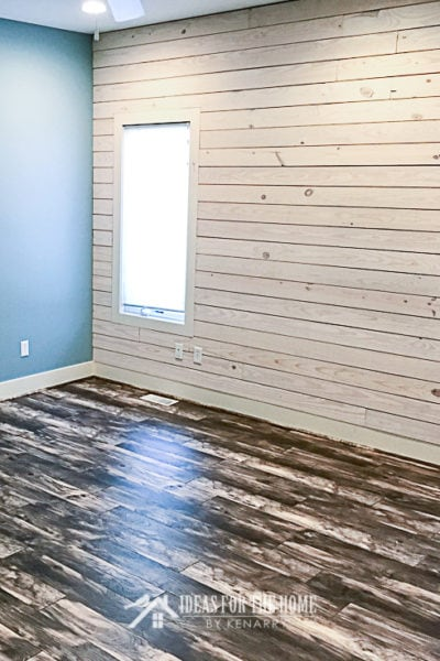 A blue room with a white shiplap wall - use this tutorial to learn how to make a shiplap wall