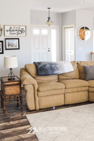 Tan sectional sofa in a farmhouse style living room