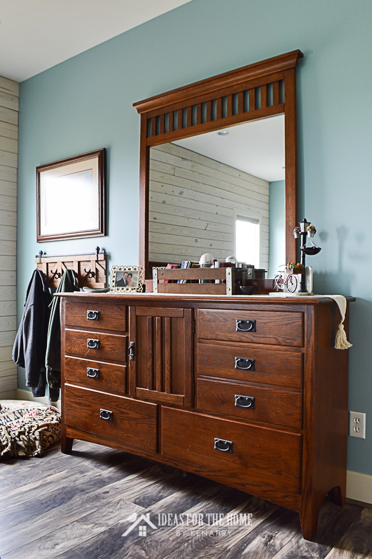 A mission style dresser with mirror in a farmhouse style master bedroom