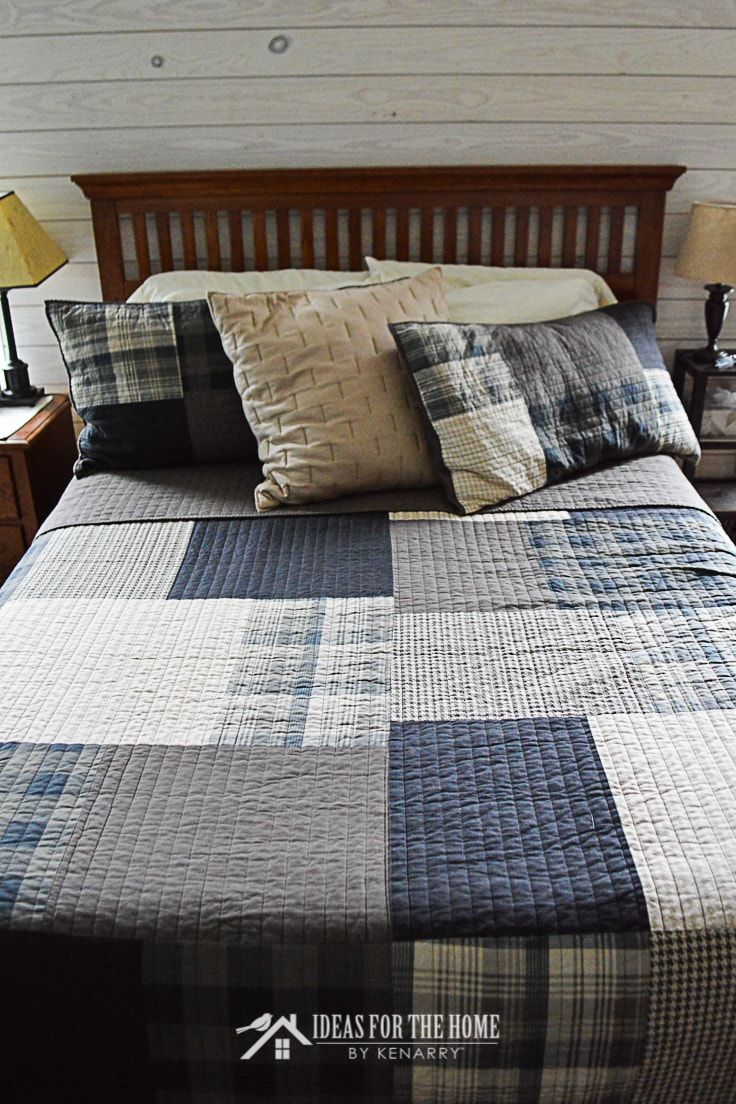 Close up of a Woolrich 3-piece Winter Hills Plaid Quilt Set on a queen sized bed in a master bedroom