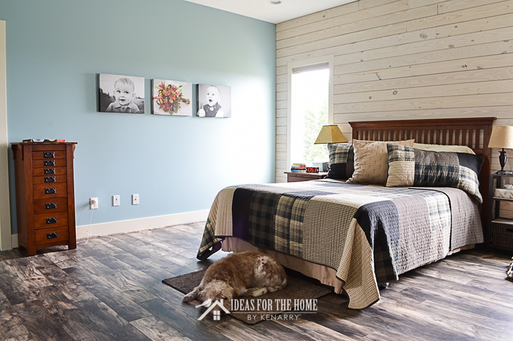Queen sized mission style bed in front of a shiplap wall