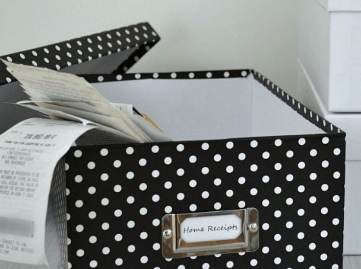 Box of home receipts to organize in a small office