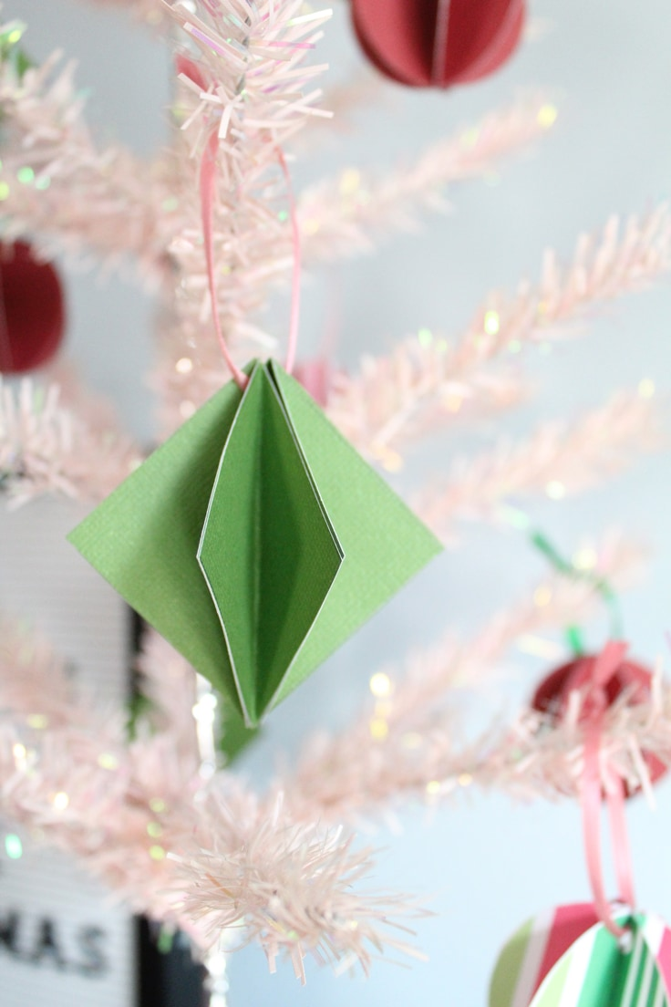 green paper ornament on a pink mini Christmas tree